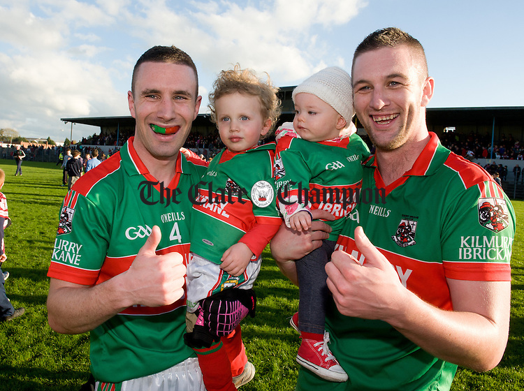 Shane Hickey and Enda Coughlan with the next generation following the senior county football final at Cusack park. Photograph by John Kelly.
