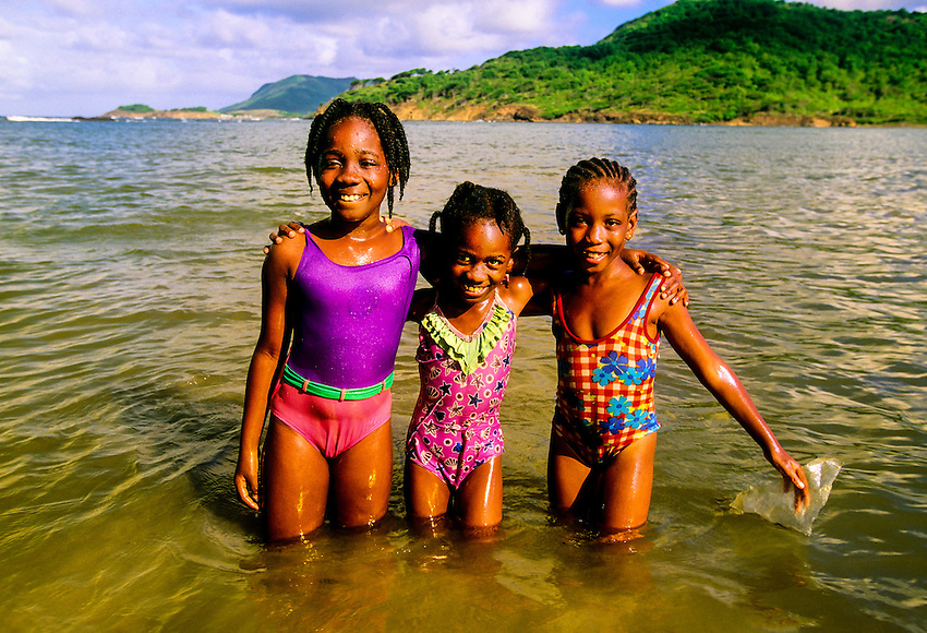 Girls enjoy the water at Cas en Bas beach (Atlantic side), island of St. Lucia