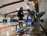 NWA Democrat-Gazette/ANDY SHUPE<br /> Ellis Stevenson (right), 6, helps volunteer Cindy Mao Friday, March 17, 2017, as they clean the bleachers in the Yvonne Richardson Community Center in Fayetteville. City staff completed a lighting and insulation upgrade for the center in 2015 that included LED lighting inside the gymnasium as well as For the YRCC we completed an LED lighting upgrade in gym that replaced 400-watt lights with brighter and more efficient 100-watt lights. The project was figured to have a 6-year pay back term.