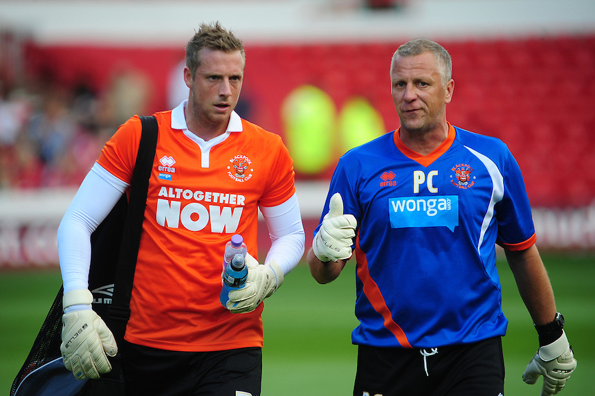 Blackpool's Elliott Parish, left, and Blackpool&rsquo;s goalkeeping coach Paul Crichton during the pre-match warm-up <br /> <br /> Photographer Chris Vaughan/CameraSport<br /> <br /> Football - The Football League Sky Bet Championship - Nottingham Forest v Blackpool - Saturday 9th August 2014 - The City Ground - Nottingham<br /> <br /> &copy; CameraSport - 43 Linden Ave. Countesthorpe. Leicester. England. LE8 5PG - Tel: +44 (0) 116 277 4147 - admin@camerasport.com - www.camerasport.com