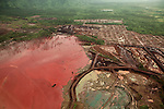 """Aerial view of Rio Tuba is the biggest and holdest mining activity in Palawan Island, 2012..Of all the seven thousand islands of the Philippines, Palawan is considered the most beautiful, the """"Last Frontier Eco"""" ..In this thin strip of land 450 km long and wide just 50, Palawan is home to 87 of 160 ethnic groups in the Philippines, 11 percent of the remaining virgin forests, over 38 percent of the mangroves, the sentries who save the earth from the aggression the sea..There had never been too peaceful revolts among the local population until the big mining companies have begun to force environmental laws that imposed the binding opinion of the inhabitants for each mining, paying """"contributions"""" to local governments and large influential chiefs and corruptible..Multibillion-dollar interests are often able to put one against the other 24 governments of the territories as large as the capital of Puerto Princesa and Taytay, or as small as Cagayancillo, a beautiful spit of land and sea of 15 square km. .On the one hand act unscrupulous men willing to give up the island and its gems, other conservationists terrified by the impact of mines on the already precarious ecological balance, in this era of rising of the sea to the greenhouse effect..Palawan hides it rich minerals, natural gas and long caves, as well as that of 8 km inside the underground river which flows the second in the world. But it is his main Mantalingahan mountain - sacred to the indigenous and fertile heart of the special microclimate - the mouthful more appetite with scattered deposits of nickel per thousand square kilometers of virgin forest.."""