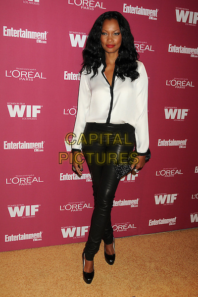 Garcelle Beauvais.2011 Entertainment Weekly Women In Film Pre-Emmy Party held at BOA Steakhouse, West Hollywood, California, USA..September 16th, 2011.full length black leather trousers white blouse clutch bag.CAP/ADM/BP.©Byron Purvis/AdMedia/Capital Pictures.