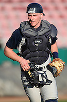 Catcher Forest Johnson #30 of the Notre Dame Fighting Irish during the Big East-Big Ten Challenge vs. the Purdue Boilermakers at Al Lang Field in St. Petersburg, Florida;  February 19, 2011.  Notre Dame defeated Purdue 19-2.  Photo By Mike Janes/Four Seam Images