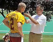 Ashburn, VA - June 11, 2008 -- Washington Redskins Head Coach Jim Zorn gives some instruction to rookie quarterback Derek Devine (2) following an organized team activity (OTA) as part of their preparations for the 2008 National Football League season at their training facility, Redskins Park in Ashburn, Virginia on Wednesday, June 11, 2008.  Devine, out of Marshall, was signed as an unrestricted free agent on May 6, 2008.  He spent the 2007 pre-season with the Seattle Seahawks, but was released prior to the season..Credit: Ron Sachs / CNP