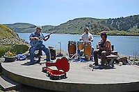 Musicians, guitarists, drummer, have a jam session on bandstand on the r bank of the Russian River, at Jenner, California, USA. 20130429034<br /> <br /> Copyright Image from Victor Patterson, 54 Dorchester Park, Belfast, UK, BT9 6RJ<br /> <br /> Tel: +44 28 9066 1296<br /> Mob: +44 7802 353836<br /> Voicemail +44 20 8816 7153<br /> Skype: victorpattersonbelfast<br /> Email: victorpatterson@me.com<br /> Email: victorpatterson@ireland.com (back-up)<br /> <br /> IMPORTANT: If you wish to use this image or any other of my images please go to www.victorpatterson.com and click on the Terms &amp; Conditions. Then contact me by email or phone with the reference number(s) of the image(s) concerned.