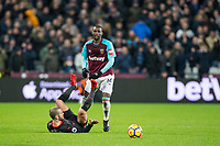 Pedro Obiang of West Ham United looks on as Jack Wilshere of Arsenal is floored during the Premier League match between West Ham United and Arsenal at the Olympic Park, London, England on 13 December 2017. Photo by Andy Rowland.