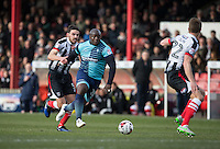 Adebayo Akinfenwa of Wycombe Wanderers under pressure from Shaun Pearson of Grimsby Town during the Sky Bet League 2 match between Grimsby Town and Wycombe Wanderers at Blundell Park, Cleethorpes, England on 4 March 2017. Photo by Andy Rowland / PRiME Media Images.