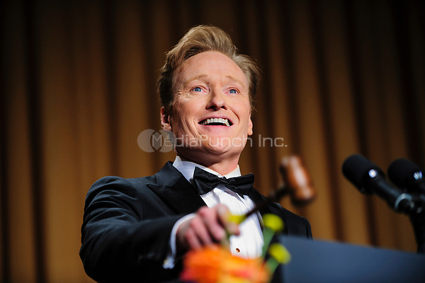 Comedian Conan O'Brien delivers a comedy routine during the White House Correspondents' Association (WHCA) annual dinner in Washington, District of Columbia, U.S., on Saturday, April 27, 2013.<br /> Credit: Pete Marovich / Pool via CNP /MediaPunch