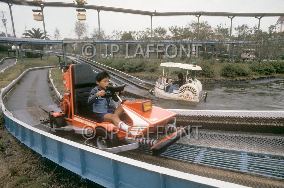 October, 1980. Suzuka, Japan. A child enjoys taking a ride in the Honda amusement park of Suzuka.
