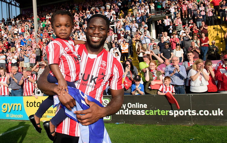 Lincoln City's John Akinde celebrates after winning the league<br /> <br /> Photographer Chris Vaughan/CameraSport<br /> <br /> The EFL Sky Bet League Two - Lincoln City v Tranmere Rovers - Monday 22nd April 2019 - Sincil Bank - Lincoln<br /> <br /> World Copyright © 2019 CameraSport. All rights reserved. 43 Linden Ave. Countesthorpe. Leicester. England. LE8 5PG - Tel: +44 (0) 116 277 4147 - admin@camerasport.com - www.camerasport.com