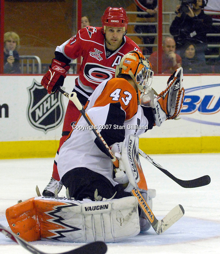 The Philadelphia Flyers' goalie Martin Biron (43) catches a puck as the Carolina Hurricanes' Cory Stillman watches from behind during their game Wednesday, Nov. 21, 2007 in Raleigh, NC. The Flyers won 6-3.
