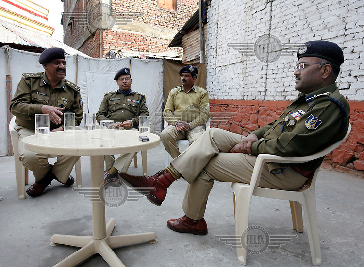 Deputy Inspector General of Police (Operations) MP Nathanael (right), in a meeting with senior officers. Nathanael leads the Central Reserve Police Force (CRPF) in and around Srinagar.  Srinagar, Kashmir, India. © Fredrik Naumann/Felix Features