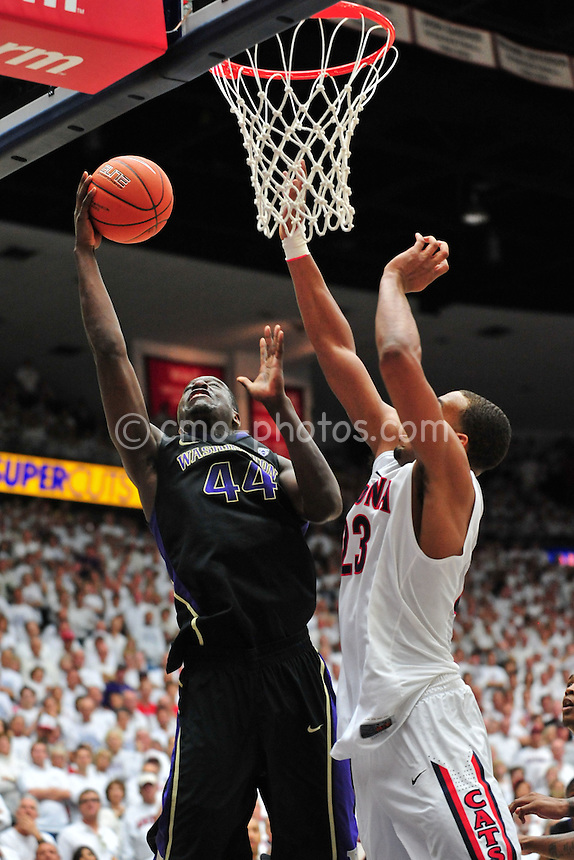 Feb 19, 2011; Tucson, AZ, USA; Arizona Wildcats forward Derrick Williams (23) tries to block the shot of Washington Huskies forward Darnell Gant (44) in the 2nd half of a game at the McKale Center.  The Wildcats won 87-86.