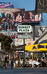 Outdoor cafe and billboards on the Sunset Plaza section of the Sunset Strip in Los Angeles, CA