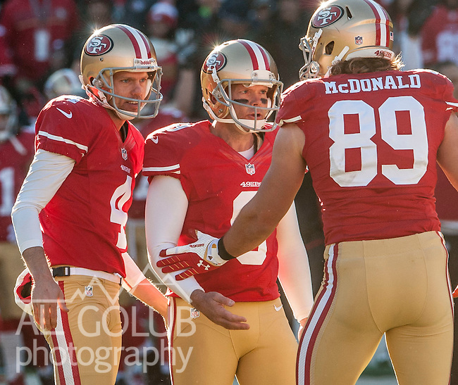 San Francisco 49ers punter Andy Lee (4) and tight end Vance McDonald (89) congratulates kicker Phil Dawson (9) after making field goal on Sunday, December 8, 2013 in San Francisco, California. The 49ers defeated the Seahawks. 19-17.