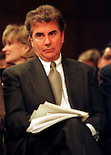 """John Walsh, host of Fox-TV's """"America's Most Wanted"""" waits for his turn to testify before the United States Senate Judiciary Subcommittee considering the """"Victim's Rights"""" Constitutional Amendment in Washington, D.C. on April 16, 1997..Credit: Ron Sachs / CNP"""