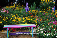 63821-18512 Rainbow bench, obelisk, and birdhouse in flower garden, Marion Co. IL