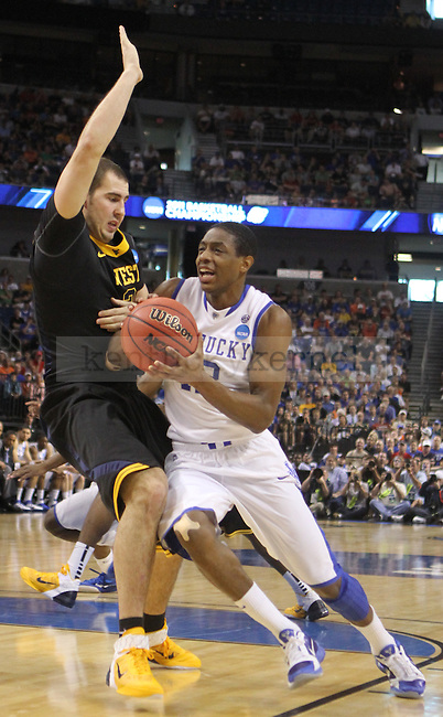 Brandon Knight drives the ball in UK's second game of the 2011 NCAA Basketball Tournament, at the St. Pete Times Forum, in Tampa, Fl.  Kentucky beat West Virginia 71-63.  Photo by Latara Appleby | Staff