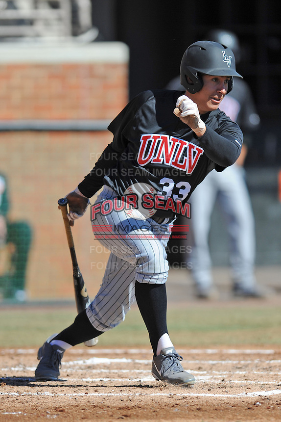 UNLV Runnin' Rebels left fielder Johnathan Torres #33 swings at a pitch during a game against the Tennessee Volunteers at Lindsey Nelson Stadium on February 22, 2014 in Knoxville, Tennessee. The Volunteers defeated the Rebels 5-4. (Tony Farlow/Four Seam Images)