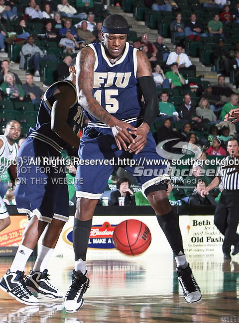 Florida International University Panthers forward Eric Fredrick (15) misses a rebound in the NCAA  basketball game between the Florida International University Panthers and the University of North Texas Mean Green at the North Texas Coliseum,the Super Pit, in Denton, Texas. UNT defeated FIU 87 to 77