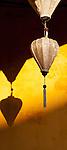Ochre Wall Silk Lanterns - Silk lanterns on an ochre wall, Hoi An, Viet Nam