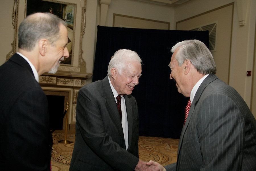 Jon Kaplan (left) chats with Bill Kurtis (right) and Jimmy Carter at the special reception before PCC's Golden Trumpet Awards dinner. President Carter delivered the keynote speech. Bill Kurtis emceed. PCC recognized the regions best strategic communications work done in 2013 at the Golden Trumpet Awards dinner at the Palmer House in downtown Chicago on Wednesday, June 4, 2014 [Photo by Karen Kring]
