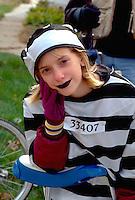 Girl age 14 in prisoner costume at Anoka Halloween Festival Parade.  Anoka Minnesota USA