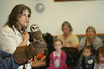 NAUGATUCK, CT, 29 September, 2017 - 092917LW01 - Chris Wrobel, left, holds Sprite, a northern saw-whet owl while Mary-Beth Kaeser speaks about the rescued creature to a group of pre-schoolers at the Whittemore Library in Naugatuck Friday morning. Spite is an educational raptor from Horizon Wings, a wildlife rehabillitation center based in Ashford. <br /> Laraine Weschler Republican-American