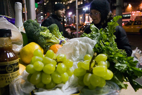 Arnaldo and Wendy bundle up against the cold and dive into the garbage bags outside D'Agnostino's, recovering a massive amount of fresh food and unexpired products.