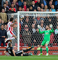Eric Maxim Choupo-Moting of Stoke City heads in to score his second goal past Goalkeeper David De Gea of Man Utd during the Premier League match between Stoke City and Manchester United at the Britannia Stadium, Stoke-on-Trent, England on 9 September 2017. Photo by Andy Rowland.