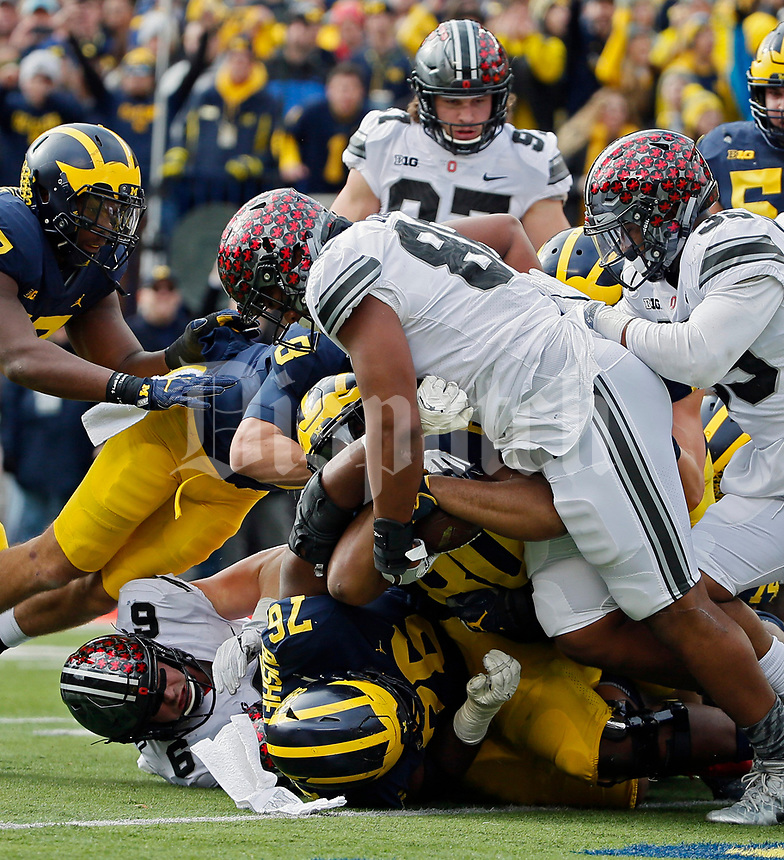 Michigan Wolverines fullback Khalid Hill (80) scores a rushing touchdown against Ohio State Buckeyes defensive lineman Dre'Mont Jones (86) during the 1st half of their game at Michigan Stadium on November 25, 2017.  [Kyle Robertson\ Dispatch]