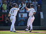 Reno Aces' Todd Glaesmann high-fives Dan Rohlfing after he hit a two-run homer against the Tacoma Rainiers at Greater Nevada Field in Reno, Nev., on Sunday, Aug. 28, 2016. <br /> Photo by Cathleen Allison