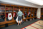 Wisconsin Badgers women's hockey equipment manager Paul Hickman places practice jerseys in the new lockers on move-in day at the LaBahn Arena Monday, October 1, 2012 in Madison, Wisc. (Photo by David Stluka)