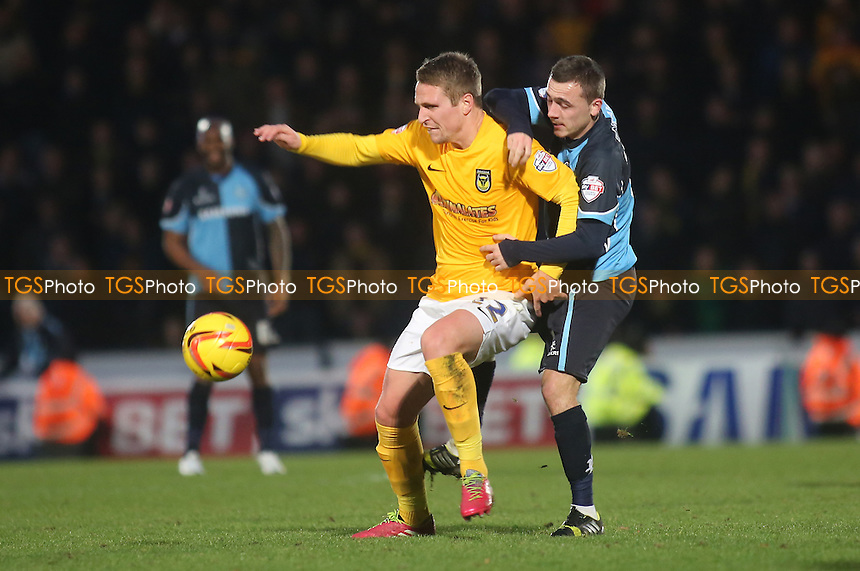 Nicky Wroe of Oxford shields the ball from Wycombe's Josh Scowen - Wycombe Wanderers vs Oxford United - Sky Bet League Two Football at Adams Park, High Wycombe, Buckinghamshire - 18/01/14 - MANDATORY CREDIT: Paul Dennis/TGSPHOTO - Self billing applies where appropriate - 0845 094 6026 - contact@tgsphoto.co.uk - NO UNPAID USE