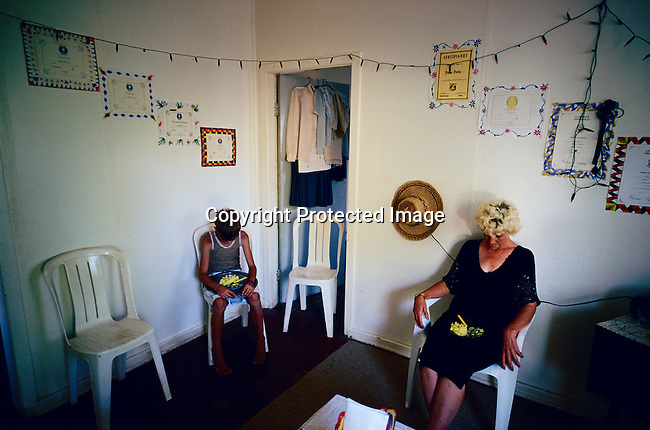 Barbara Noortman, age 53, prays before eating with her son in their living room in Orania, an all white community in South Africa. The village was founded in 1991, and bought by descendants of Hendrik Verwoerd, the architect of Apartheid. It's a private town only accepting whites and about 600 Afrikaners celebrate their culture and keep traditions alive. (Photo by: Per-Anders Pettersson)