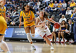 SIOUX FALLS, SD - MARCH 8: Lauren Loven #3 of the Denver Pioneers drives to the basket against the North Dakota State Bison defense at the 2020 Summit League Basketball Championship in Sioux Falls, SD. (Photo by Dave Eggen/Inertia)