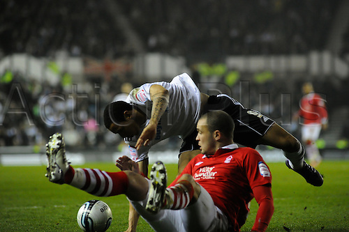 13.03.2012 Derby, England. Derby County v Nottingham Forest. Nathan Tyson (Derby County)  and Greg Cunningham (Nottingham Forest) in action during the NPower Championship game played at the Pride Park Stadium. Derby won the game by a score of 1-0.