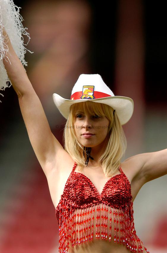 Photo: Richard Lane..London Broncos v Warrington Wolves. Tetleys Super League. 04/04/2004..Broncos cowgirl cheerleader.