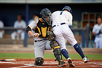 Bradenton Marauders catcher Jason Delay (5) is run over by Robbie Tenerowicz (1) on a play at the plate during a game against the Charlotte Stone Crabs on August 6, 2018 at Charlotte Sports Park in Port Charlotte, Florida.  Charlotte defeated Bradenton 2-1.  (Mike Janes/Four Seam Images)