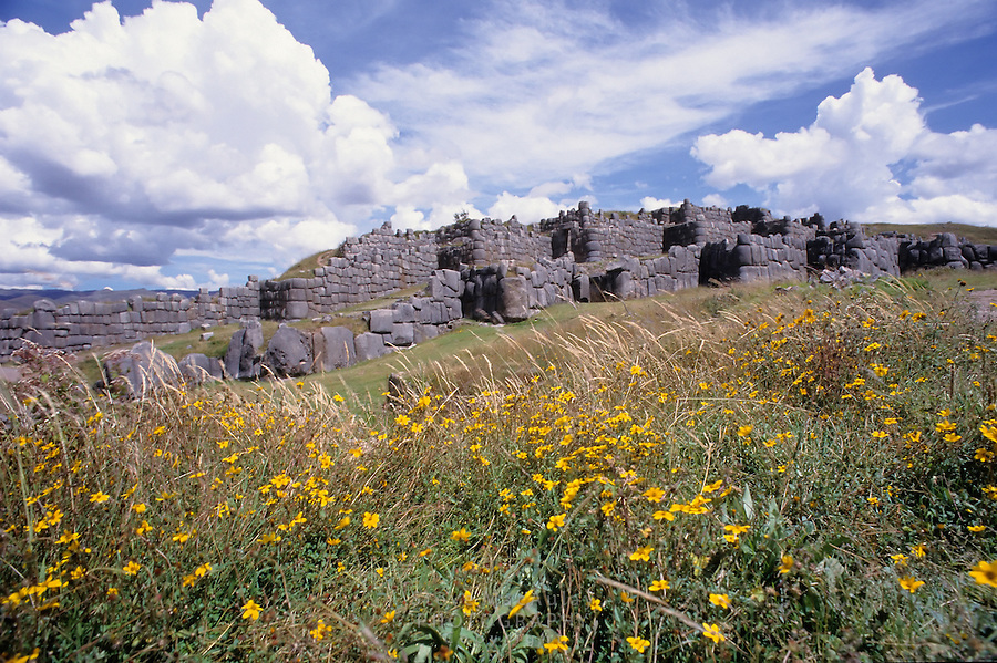 The fortress ruins of Sacsayhuaman, with the massive stone walls of caredfully fitted stone blocks.  Sacred Valley, Cusco, Peru