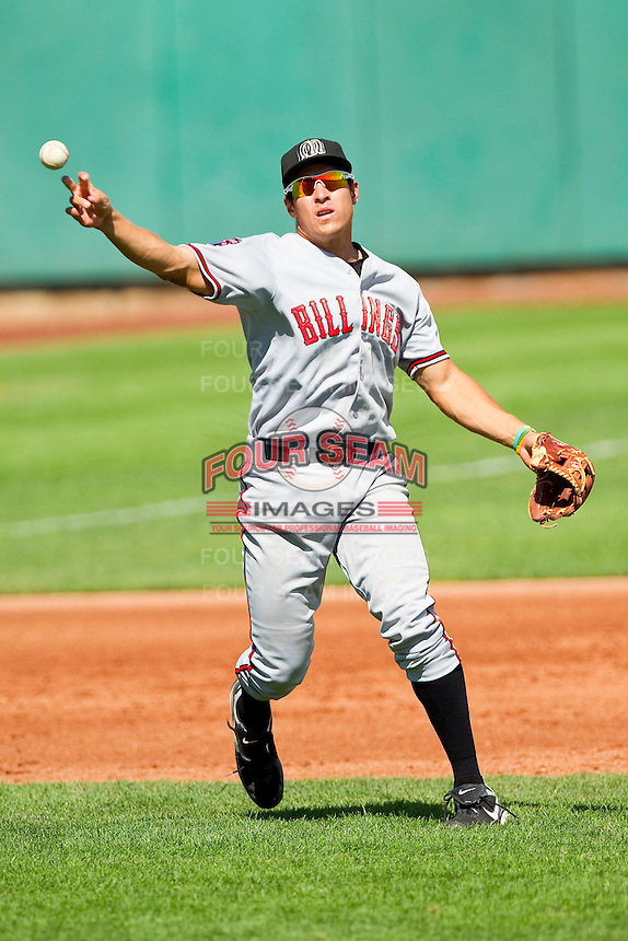 Billings Mustangs third baseman Seth Mejias-Brean (13) makes a throw to first base against the Orem Owlz at Brent Brown Ballpark on July 22, 2012 in Orem, Utah.  The Mustangs defeated the Owlz 13-8.  (Brian Westerholt/Four Seam Images)