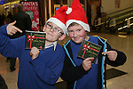 Cian Byrne and Daniel Doyle at the Christmas Carol Singing with Mell National School...Photo NEWSFILE/Jenny Matthews.(Photo credit should read Jenny Matthews/NEWSFILE)....This Picture has been sent you under the condtions enclosed by:.Newsfile Ltd..The Studio,.Millmount Abbey,.Drogheda,.Co Meath..Ireland..Tel: +353(0)41-9871240.Fax: +353(0)41-9871260.GSM: +353(0)86-2500958.email: pictures@newsfile.ie.www.newsfile.ie.FTP: 193.120.102.198.