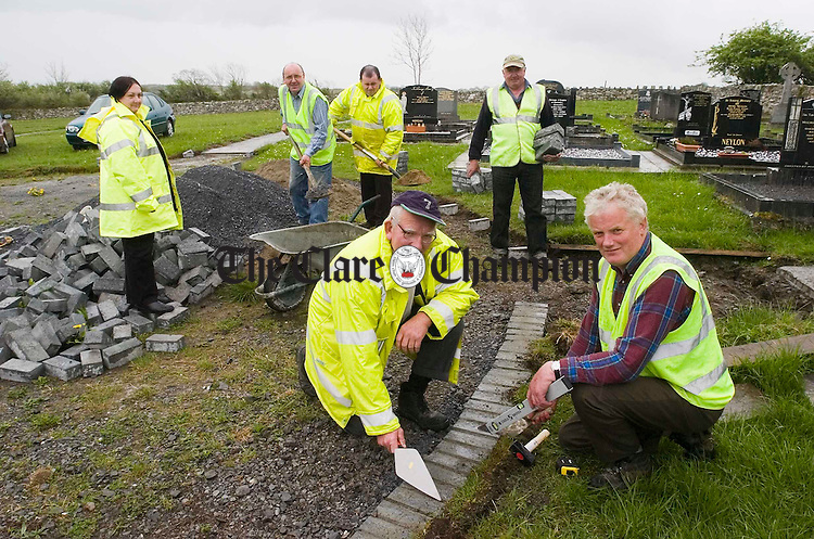 Tom Barry and Michael Murphy at front with Anne Kiernan, supervisor, Tom Barry, Joe Brody and Brendan Davin at work in Kilnamona graveyard. Photograph by John Kelly.
