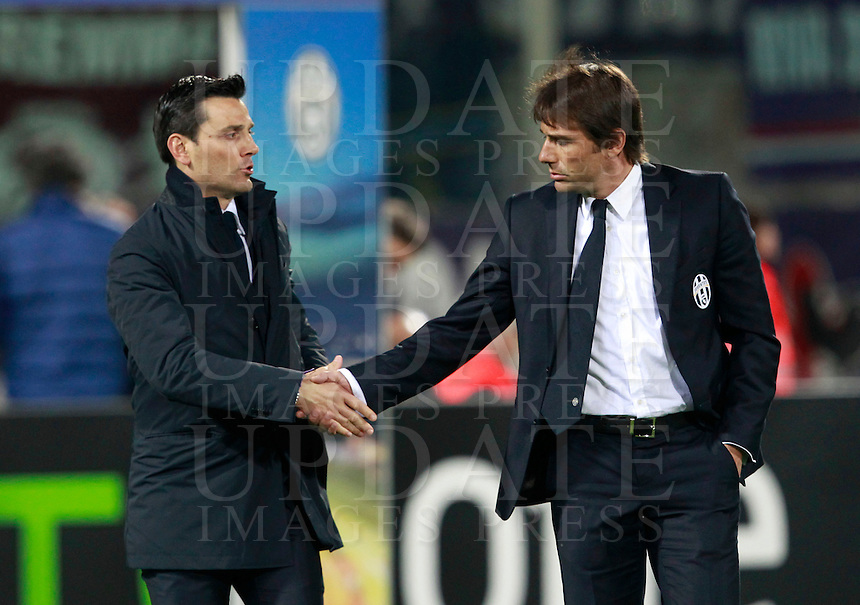 Calcio, ritorno degli ottavi di finale di Europa League: Fiorentina vs Juventus. Firenze, stadio Artemio Franchi, 20 marzo 2014. <br /> Fiorentina coach Vincenzo Montella shakes hands with Juventus coach Antonio Conte, right, prior to the start of the Europa League round of 16 second leg football match between Fiorentina and Juventus at Florence's Artemio Franchi stadium, 20 March 2014. Juventus won 1-0 to advance to the round of eight.<br /> UPDATE IMAGES PRESS/Isabella Bonotto
