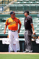 GCL Orioles manager Orlando Gomez (23) questions a call with umpire Ross Sheridan during a game against the GCL Twins on August 11, 2016 at the Ed Smith Stadium in Sarasota, Florida.  GCL Twins defeated GCL Orioles 4-3.  (Mike Janes/Four Seam Images)
