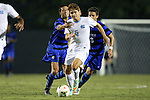 19 September 2014: North Carolina's Alan Winn (5) pushes past Duke's Sean Davis (left) and Jack Coleman (3). The Duke University Blue Devils hosted the University of North Carolina Tar Heels at Koskinen Stadium in Durham, North Carolina in a 2014 NCAA Division I Men's Soccer match. Duke won the game 2-1.