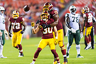 Landover, MD - August 16, 2018: Washington Redskins defensive back Troy Apke (30) and Washington Redskins defensive tackle Ondre Pipkins (78) celebrate after an interception during preseason game between the New York Jets and Washington Redskins at FedEx Field in Landover, MD. (Photo by Phillip Peters/Media Images International)