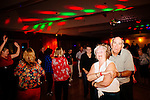 Residents shake a leg at the Rockin' Thru the Years Dance Club in the Bell Social Hall in Sun City, Arizona November 30, 2013.