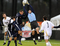 Virginia Cavaliers goalkeeper Diego Restrepo (1) grabs a ball in traffic during overtime. The Virginia Cavaliers defeated the Akron Zips 3-2 in a penalty kick shoot out after a scoreless game and overtime in the finals of the 2009 NCAA Men's College Cup at WakeMed Soccer Park in Cary, NC on December 13, 2009.