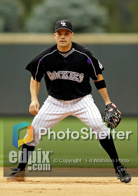 7 September 2006: Jamey Carroll, second baseman for the Colorado Rockies, takes warm-up drills prior to a game against the Washington Nationals. Carroll went 3 for 5 with 2 RBIs as the Rockies defeated the Nationals 10-5 in a rain-delayed game at Coors Field in Denver, Colorado. ..Mandatory Photo Credit: Ed Wolfstein..
